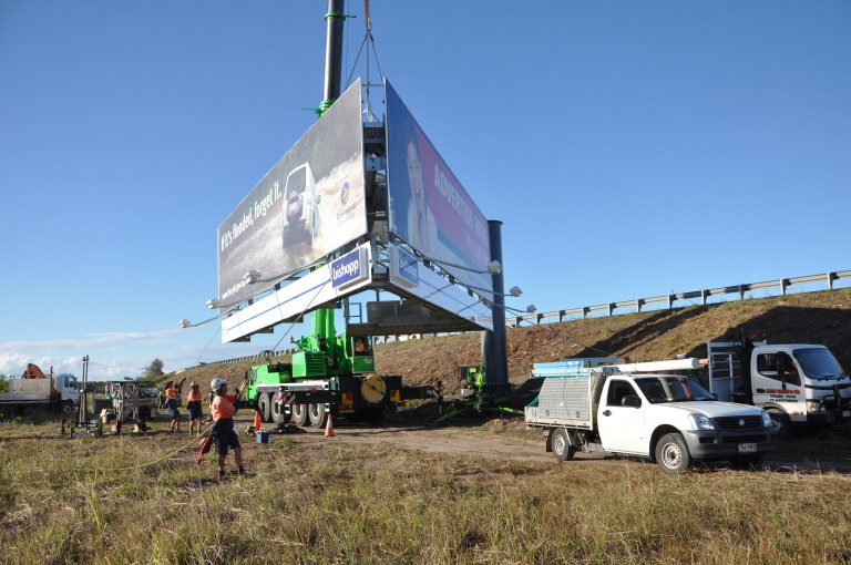 Bishopp Billboard Construction - construction crane lifts billboard into position